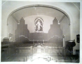 The missing Greene window, seen in its last known location in 1951 (when the current Fellowship Hall was used as the church's main sanctuary). (Photo from the church archives)